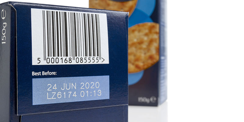 Blue cardboard box of crackers with barcode and best before date coded on bottom
