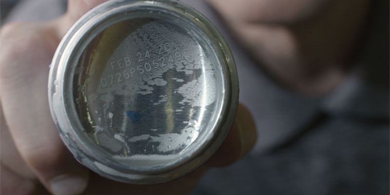 Clear fibre laser code on bottom of metal beverage can